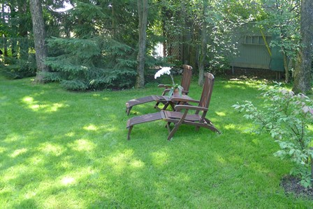 green lawn with chairs