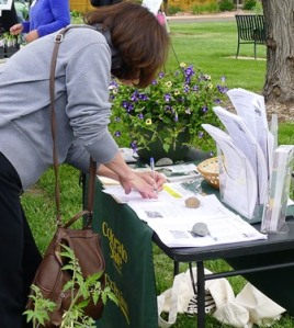 The annual plant sale is a fundraiser and also an educational outreach to the community. At the CSU Extension information table, gardeners could enter to win a hanging basket and pick up handouts on best practices for growing their vegetable gardens. A poster offered ways to deal with Japanese Beetles.